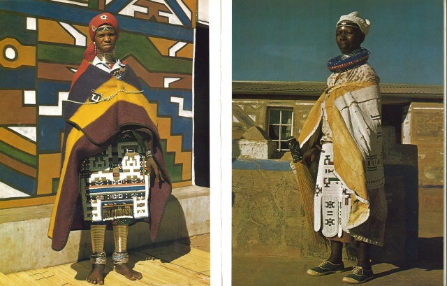"African Arts, Volume XI, Issue Number 02. January 1978. Traditional Ndebele Beadwork. Left: ""A woman wearing her mapoto stands before the brightly colored murals of her house."" Right: ""An elderly woman wearing a Linaga decorated with a broad strip of small white beads. It has designs in the traditional red-blue-green-orange color combination."" Photos by Suzanne Priebatsch & Natalie Knight."