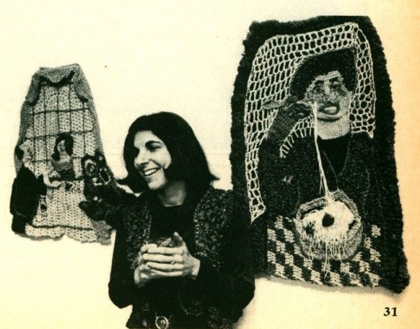 "Bonnie Meltzer with two of her crocheted yarn hangings, ""Middle Aged Date"" and ""Man Eating Spaghetti"""